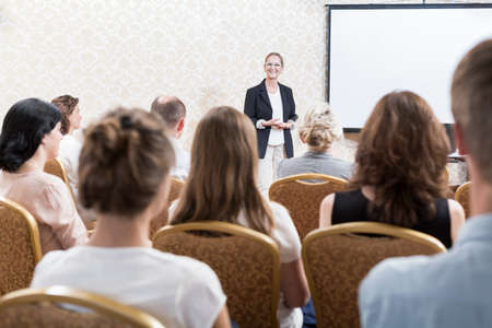 Professional woman is speaking at the conference