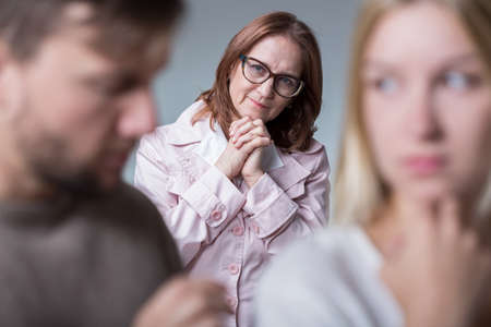 intrusive: Good mother-in-love supporting married couple Stock Photo