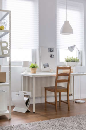 Study Desk: Image of comfortable wood chair and white desk