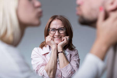 intrusive: Image of happy mother-in-law and couple in love Stock Photo