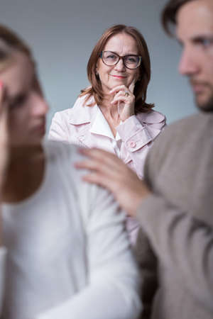 motherly: Photo of professional mature couple therapist supporting young marriage Stock Photo