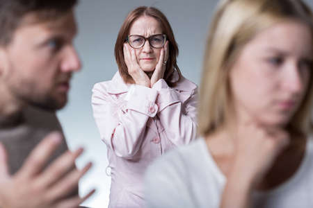 protective: Picture of protective moher worrying about her unhappy married daughter Stock Photo