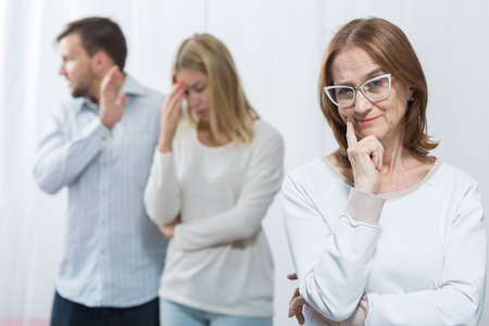 intrusive: Picture of mean envious mother and marital dispute Stock Photo
