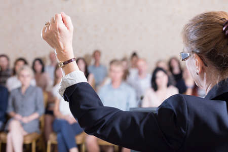 speaker: Public speaker is very excited during conference Stock Photo