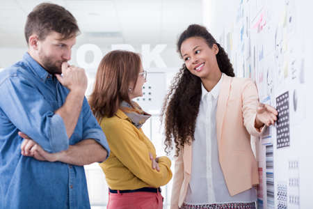 new idea: Young woman is showing her new idea