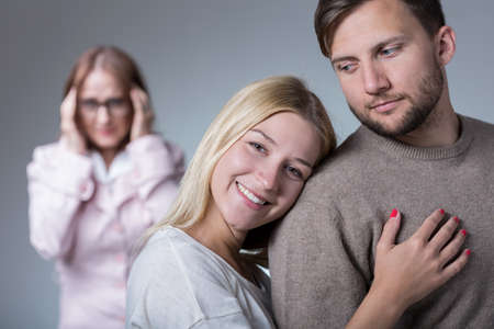intrusive: Picture of happy pair in love and overprotective mother
