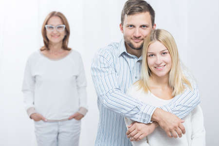 intrusive: Picture of good mother and protective husband with his wife Stock Photo