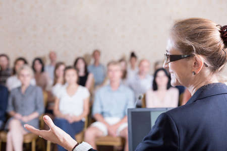 hall monitors: Experienced businesswoman is speaking during training for workers Stock Photo