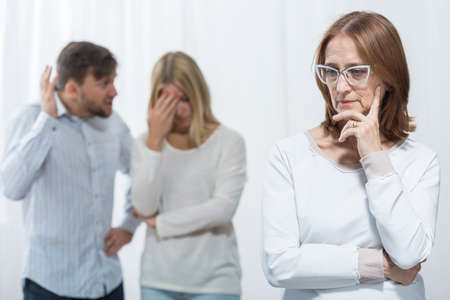 intrusive: Picture of interfering mother-in-law and marital conflict