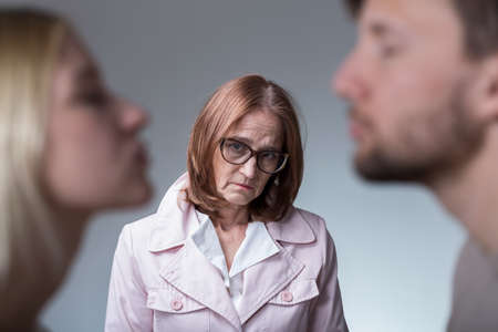 intrusive: Image of unhappy mother-in-law and her amorous son