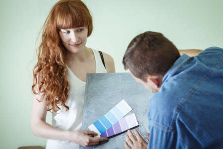 decorate: Young woman wants to decorate new flat