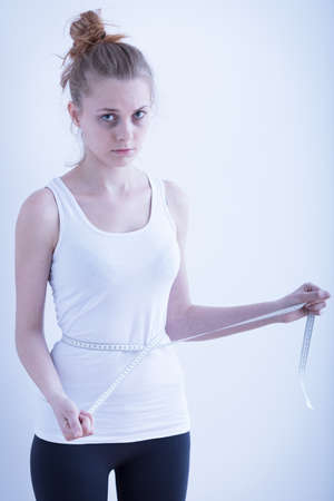 anorexia girl: Image of anorexic girl with measuring tape