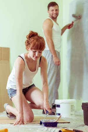redecoration: Young couple is redecorating their new flat Stock Photo