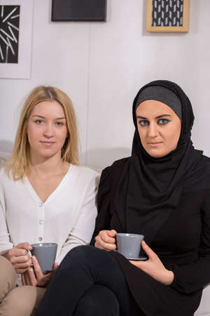 Arabic and europen friends drinking coffee together