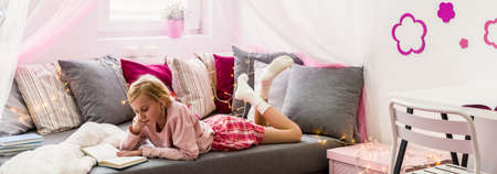Young girl is resting in her cozy room