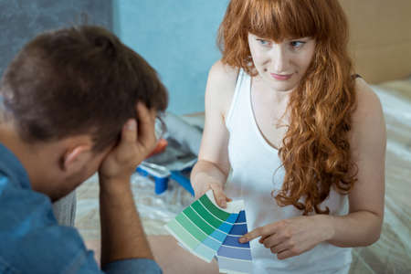 redecorating: Young woman is thinking about blue color