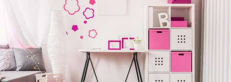 Pink and white accessories in the childs room Foto de archivo