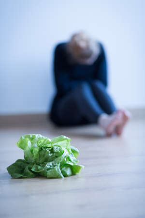 anorexia girl: Lettuce on the floor - metaphor of anorexia