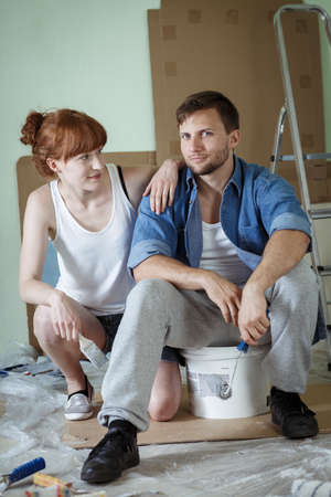 redecoration: Young couple is starting a redecoration in their flat