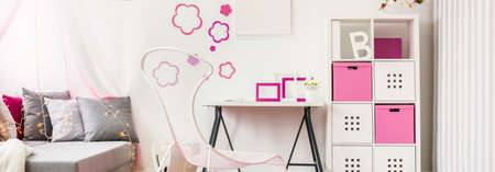 Pink and white decorations in the girls room