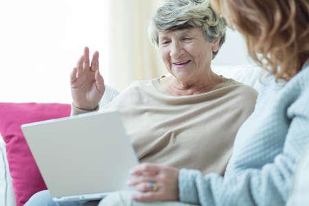 grandmother mother daughter: Close-up of daughter teaching elder mum using laptop