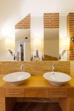 washbasins: Two washbasins in elegant wood and marble bathroom