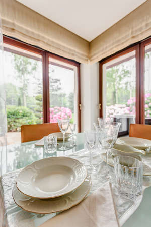 dining room: Elegant and stylish porcelain table setting for dinner Stock Photo