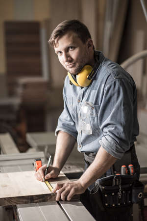 skilled: Image of skilled carpenter labouring in professional workshop Stock Photo