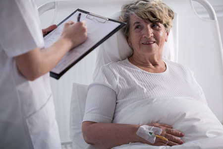 seniors care: Image of positive elderly hospital patient after operation Stock Photo