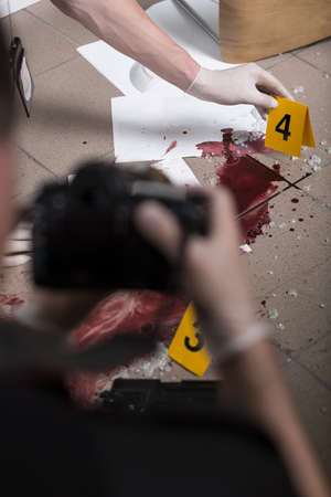 securing: Police officers are securing proofs at the crime scene Stock Photo