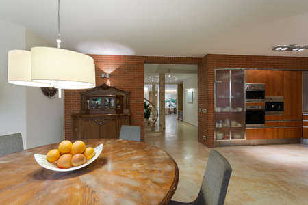 contemporary kitchen: Stylish round wooden table in contemporary kitchen