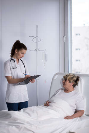 Image of oncologist and cancer woman in hospital