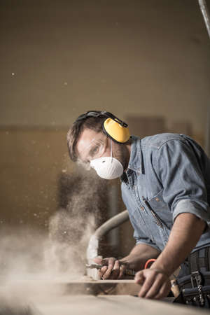 skills: Photo of joiner labouring in mask and glasses for safety