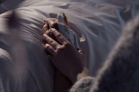 dying: Photo of woman supporting dying mother with cancer