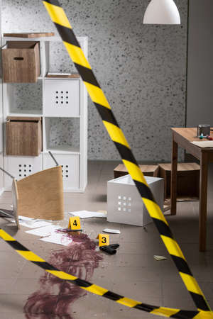 securing: Cordon tape is securing the crime scene Stock Photo