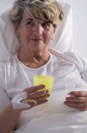 hospice: Photo of senior hospice patient taking painkillers Stock Photo