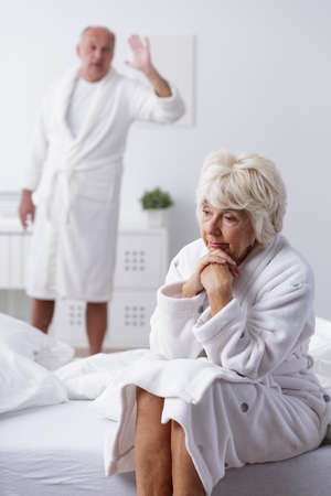 elderly woman: Image of unhappy mature married couple arguing Stock Photo