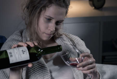 Alcoholic woman wants another glass of wine