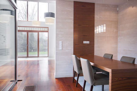 wood room: Minimalistic modern dining room in property for sale