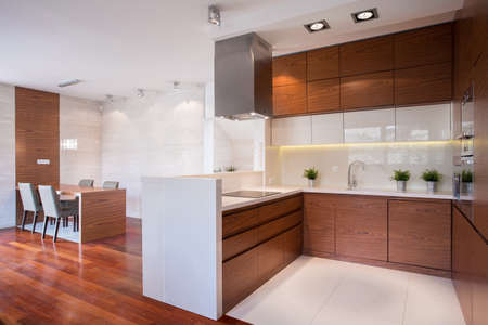 contemporary kitchen: Modern shiny kitchen in wood and marble