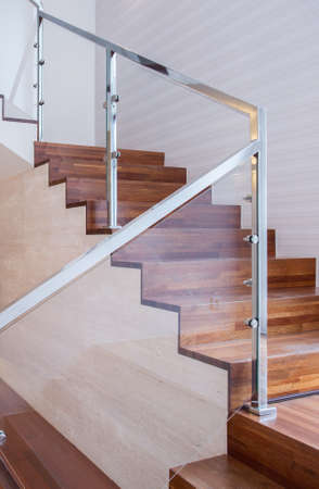 metal handrail: Modern design stairs made of wood and glass