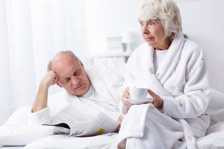 happy senior: Photo of mature marriage resting in bed in the morning