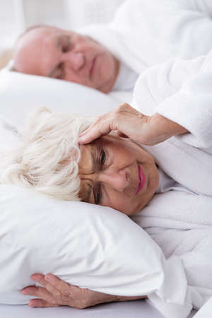 romance image: Image of snoring husband and his wife with headache