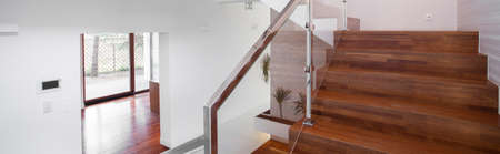 simple store: Simple style glass and wood modern stairs with metal rail