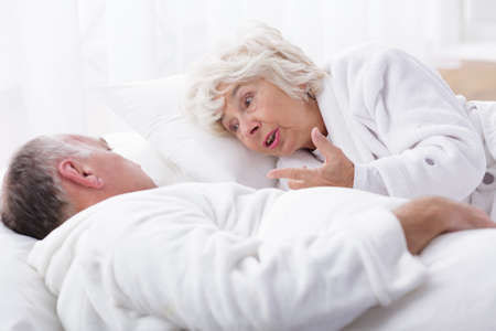 bedroom bed: Photo of mature marriage arguing in bed in the morning Stock Photo