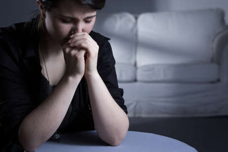 widow: Depressed young widow and grief after husband Stock Photo