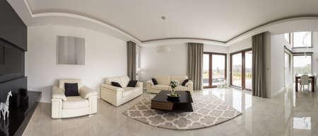 contemporary living room: Spacious minimalistic living room in contemporary design