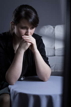 cheat: Young lonely abandoned woman sitting in dark room