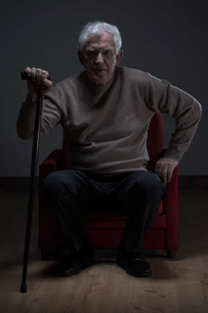 senior men: Old man with walking stick trying to stand up