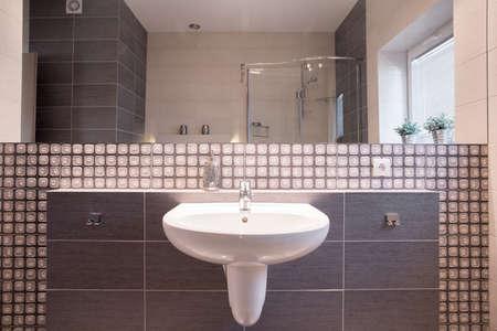 washbasin: Close-up of washbasin in brown elegant bathroom Stock Photo